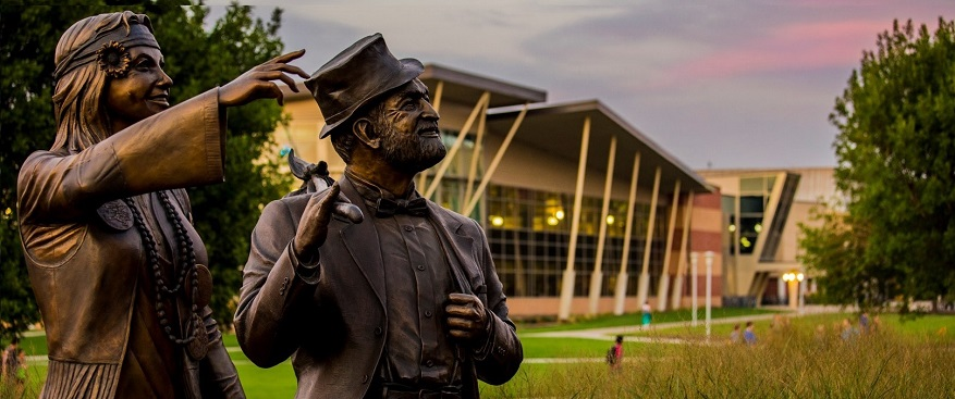 Photo of Wearly Wil and Dirty Lil statues on the Jackrabbit Green.